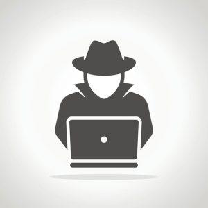 Ransomware Hacker, hacking into laptop